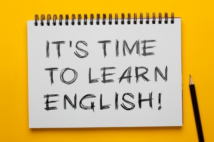 Блокнот с надписью it's time to learn english